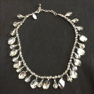 Beautiful gray glass like necklace .